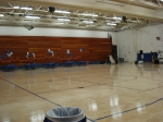 Old gym with only one side of bleachers now.